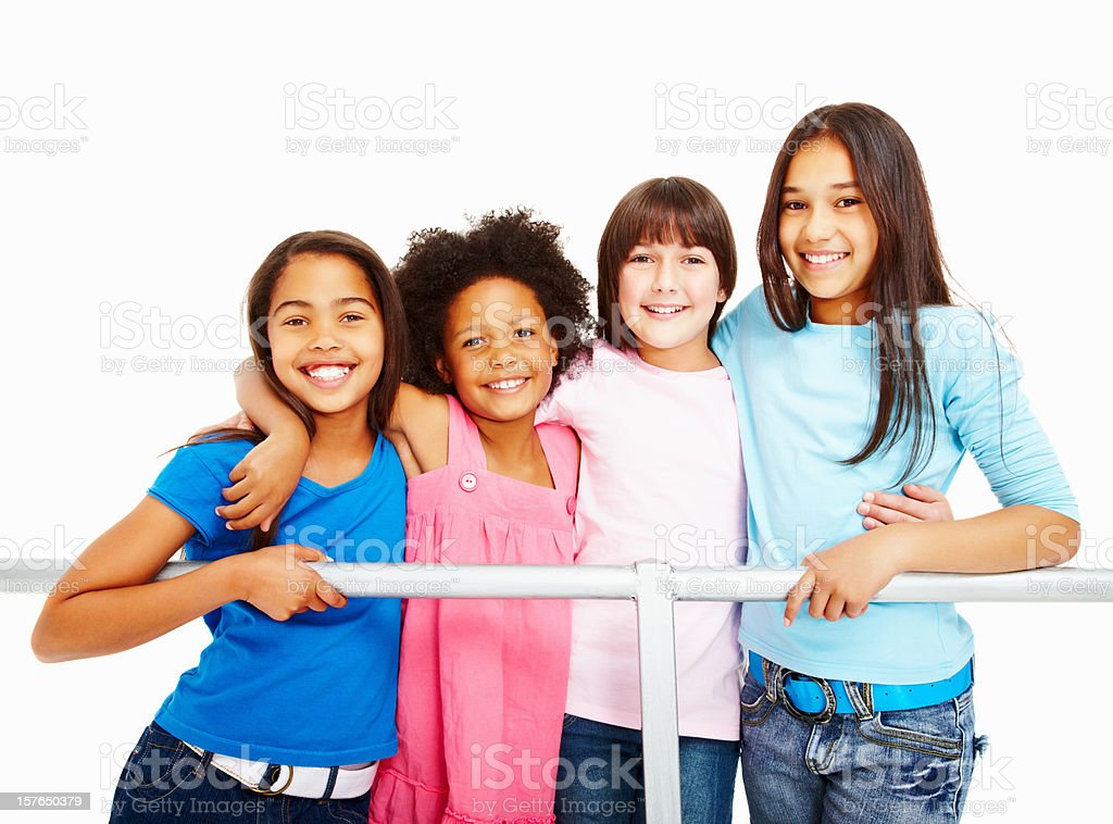 Multi ethnic female friends standing by railing against white royalty-free stock photo