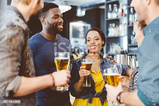 istock Multi ethnic friend having party in a pub 487464968