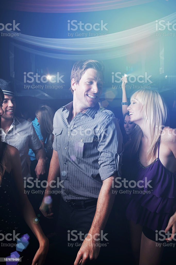 Multi ethnic friends enjoying at a party royalty-free stock photo