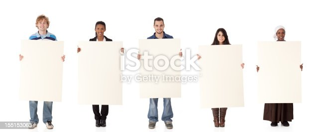 istock Multi ethnic group holding a sign. 155153063