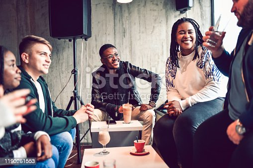 Multi Ethnic Group Of Friends Having A Coffee Together And Sharing Cultural Traits