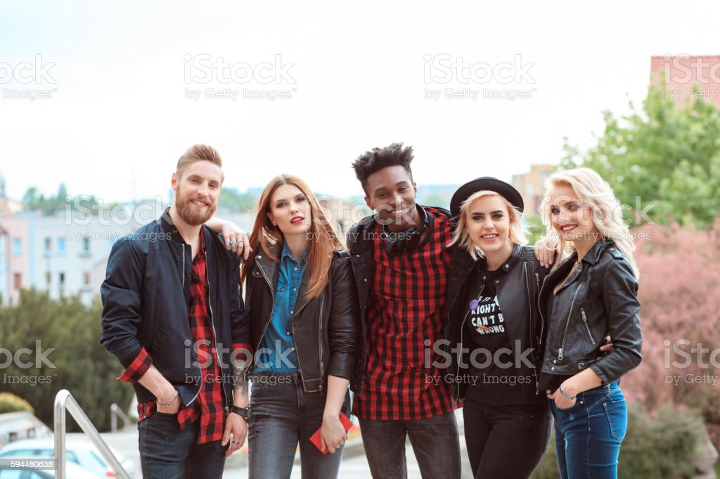 Multi ethnic group of friends, outdoor portrait Outdoor portrait of multi ethnic group of care young people, smiling at the camera. 20-29 Years Stock Photo