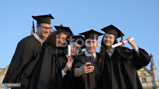 Medium shot. Multi ethnic group of graduated students taking selfie. Professional shot in 4K resolution. 035. You can use it e.g. in your commercial video, medical, business, presentation, broadcast