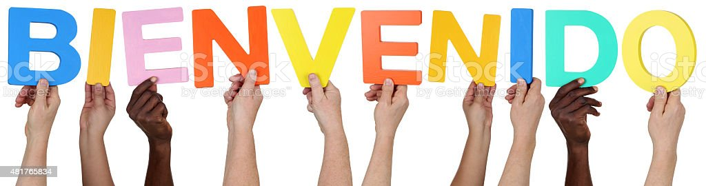 Multi ethnic group of people holding Spanish word bienvenido welcome stock photo