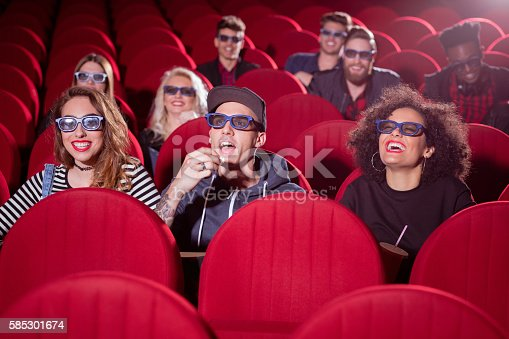 istock Multi ethnic group of people in the 3D movie theater 585301674