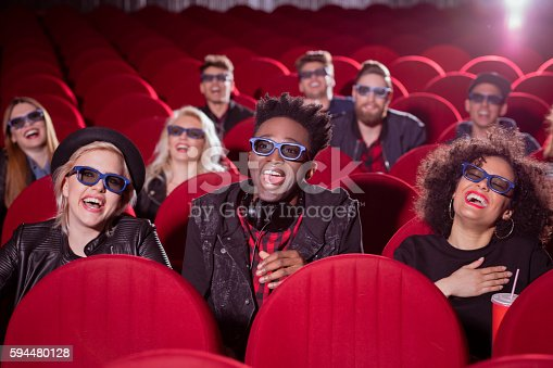istock Multi ethnic group of people in the 3D movie theater 594480128