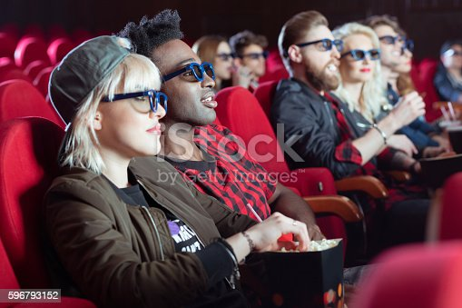istock Multi ethnic group of people in the 3d movie theater 596793152