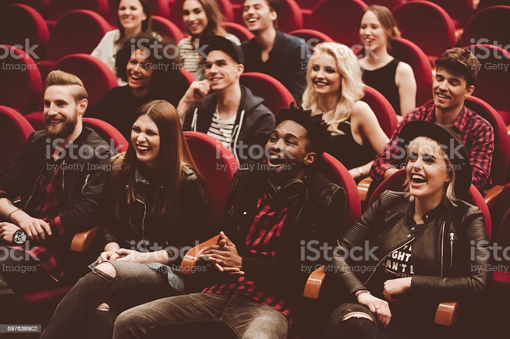 Multi ethnic group of people in the movie theater stock photo