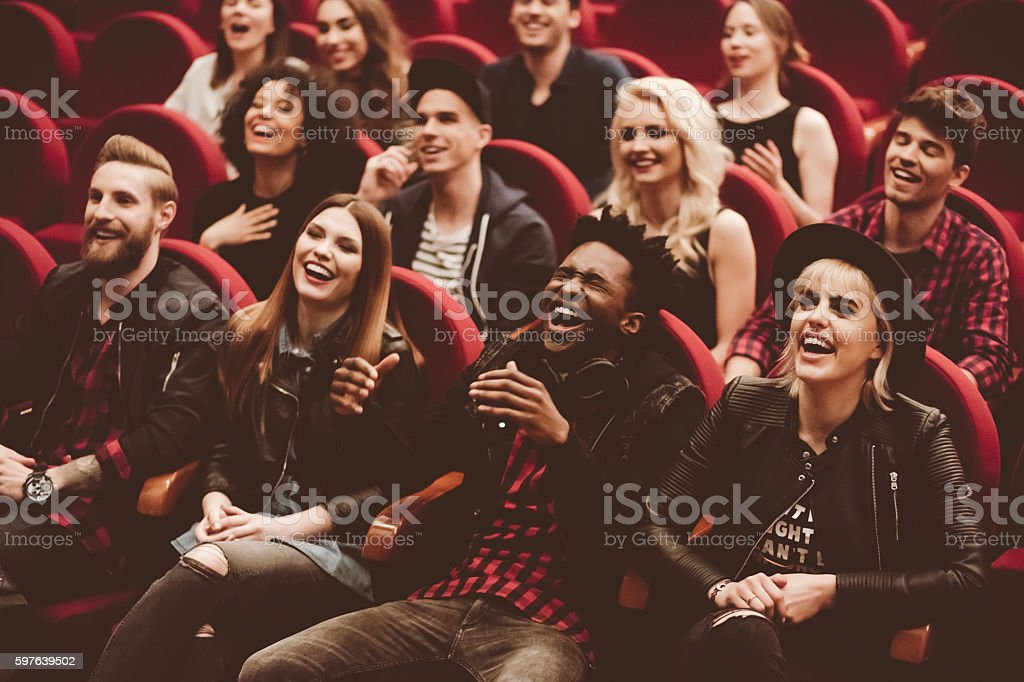 Multi ethnic group of people in the movie theater - foto de stock