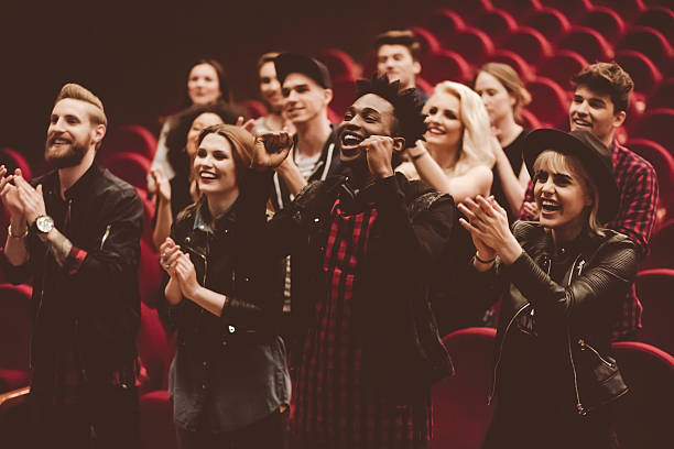 Multi ethnic group of people in the theater - foto de acervo