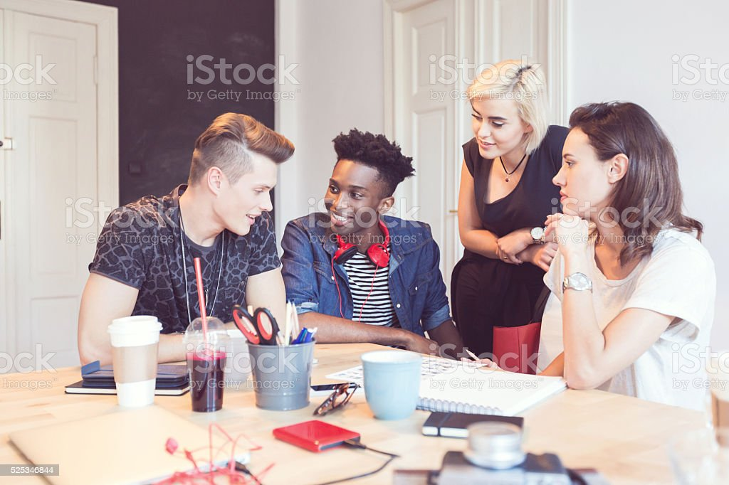 Multi ethnic group of students working together stock photo