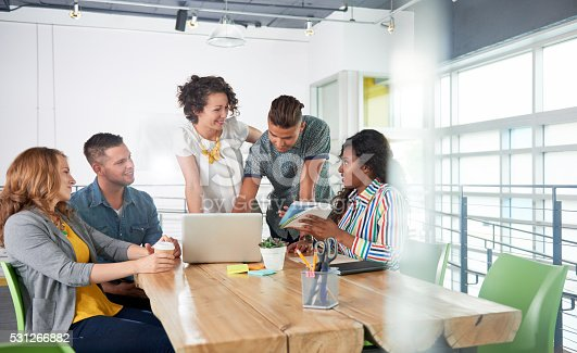 istock Multi ethnic group of succesful creative business people using a 531266882