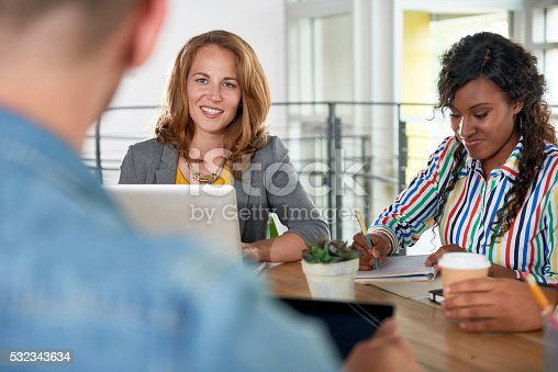 istock Multi ethnic group of succesful creative business people using a 532343634