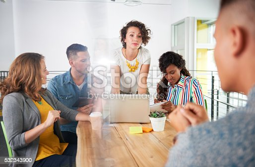 istock Multi ethnic group of succesful creative business people using a 532343900