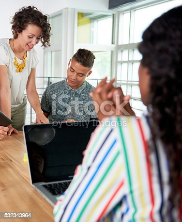 istock Multi ethnic group of succesful creative business people using a 532343964