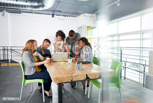 istock Multi ethnic group of succesful creative business people using a 537636014
