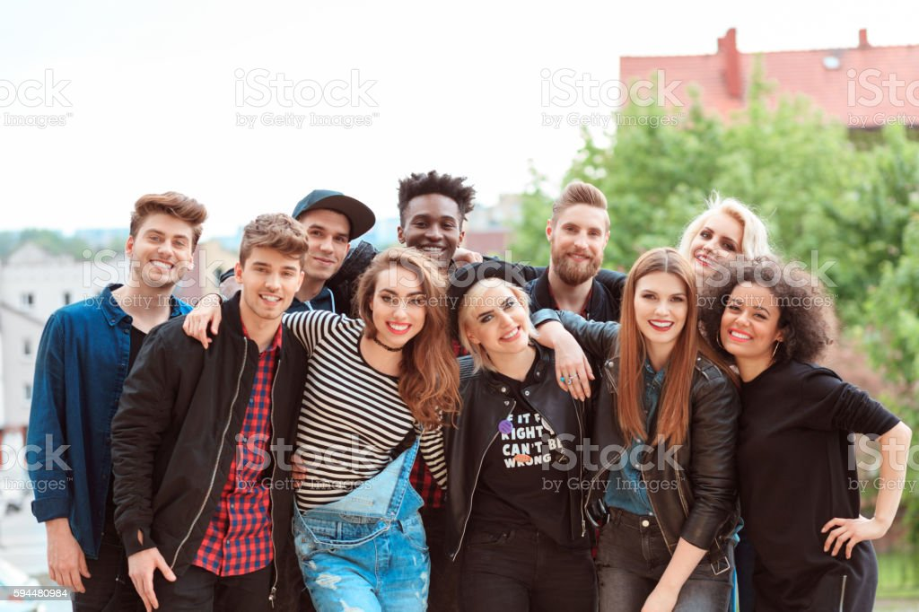Multi ethnic group of young people Multi ethnic group of cool young people laughing at the camera, outdoors portrait. 20-29 Years Stock Photo