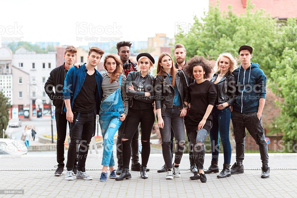 Multi ethnic group of young people Multi ethnic group of cool young people, outdoors portrait. 20-29 Years Stock Photo