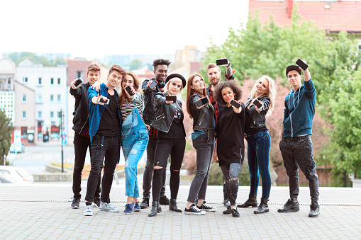 Multi Ethnic Group Of Young People With Mobile Phones Stock Photo - Download Image Now