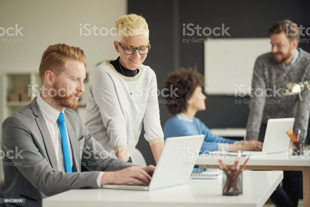 Multi ethnic group working in office royalty-free stock photo