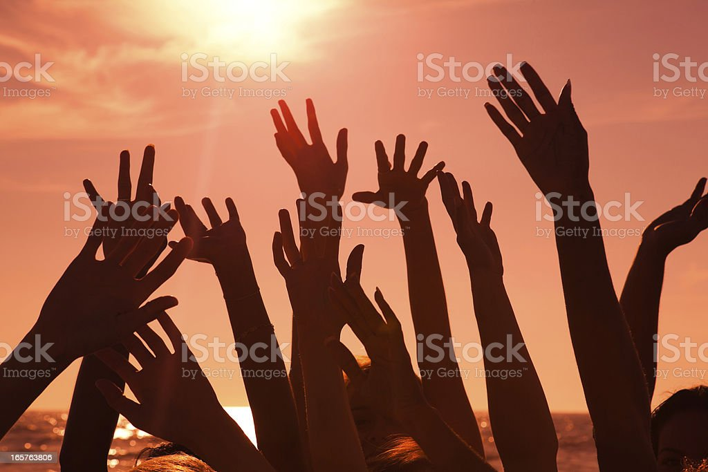 Multi ethnic hands at sunset royalty-free stock photo