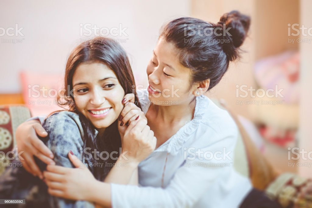 Multi ethnic happy female lovers at home. stock photo