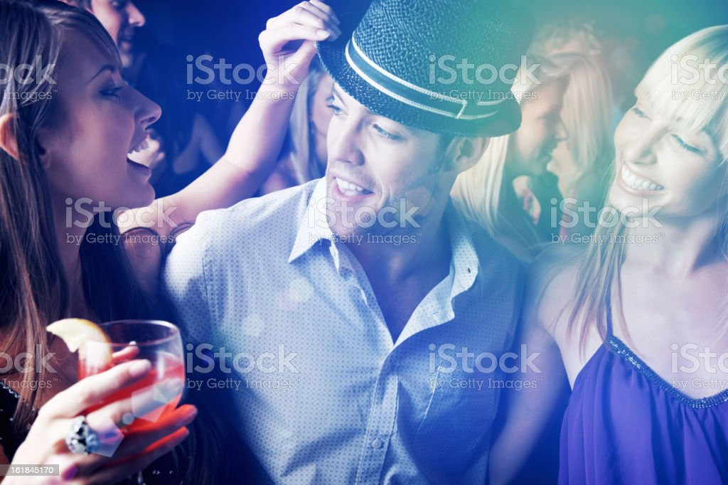 Multi ethnic people having fun in nightclub at a party royalty-free stock photo