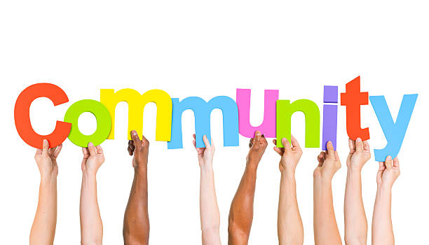 multi ethnic people holding the word community - help single word stock photos and pictures