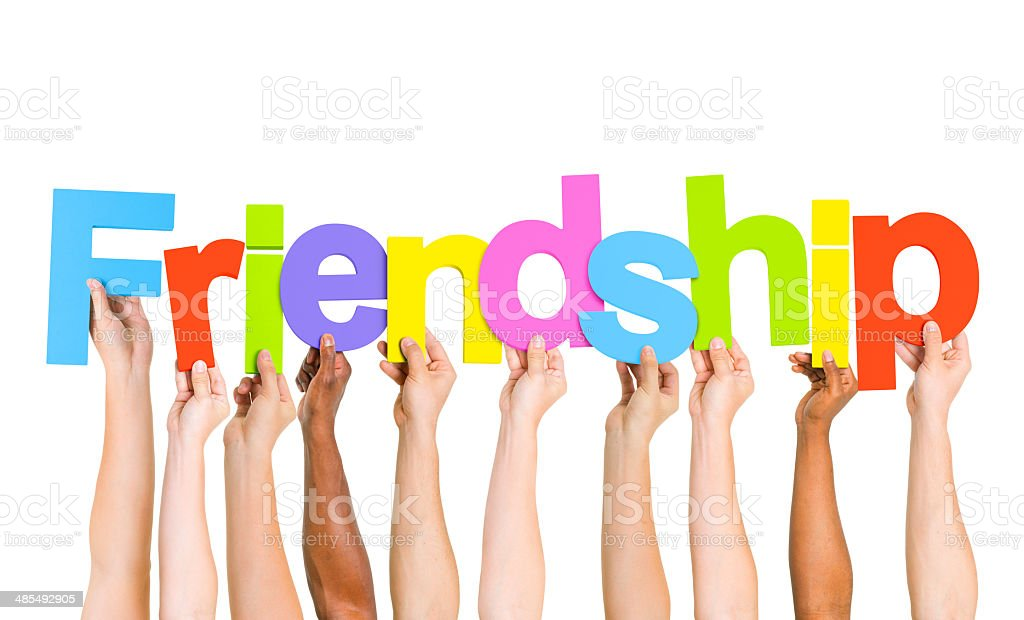 Multi Ethnic People Holding The Word Friendship royalty-free stock photo