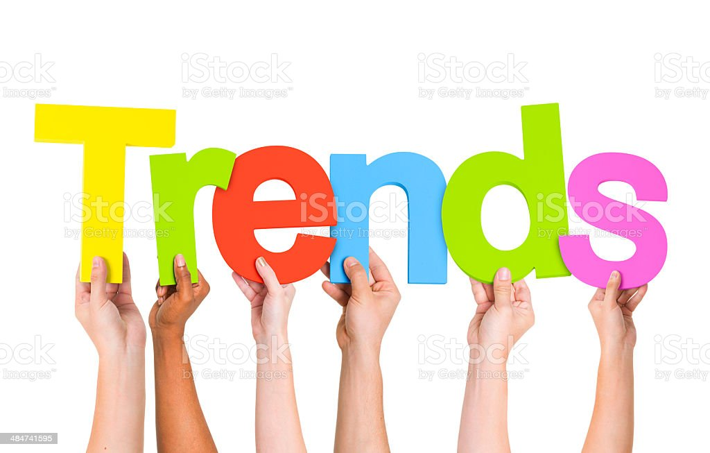 Multi Ethnic People Holding The Word Trends stock photo