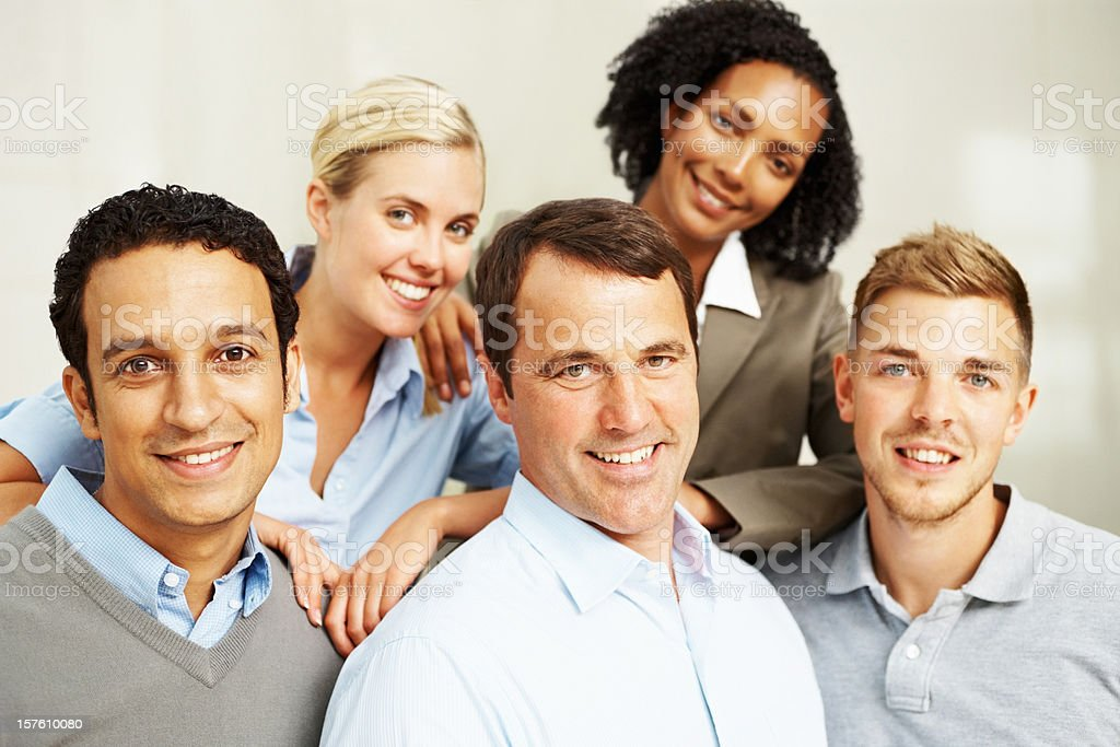 Multi ethnic team of smiling business colleagues royalty-free stock photo