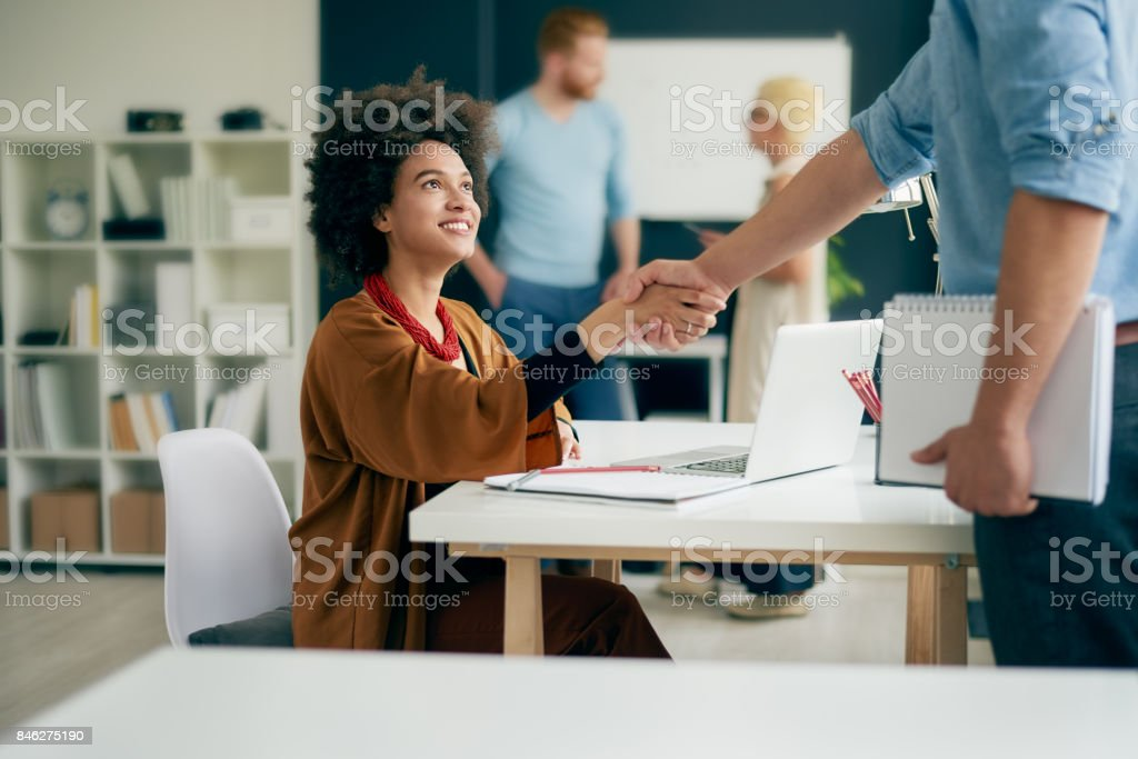 Multi ethnic team working in modern office stock photo