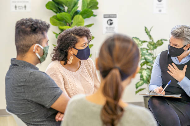 Multi ethnic therapy group during pandemic stock photo