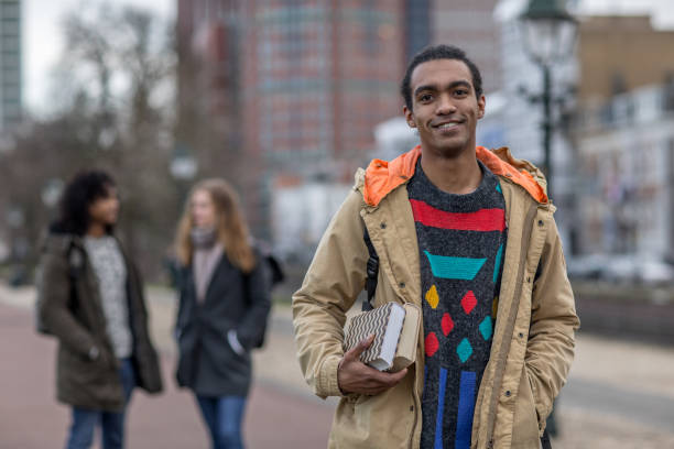 Multi ethnic university student going to classes in the Netherlands stock photo