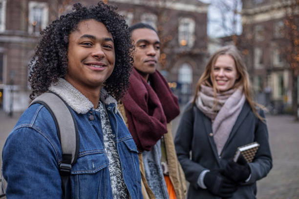 Multi ethnic university students going to classes in the Netherlands stock photo