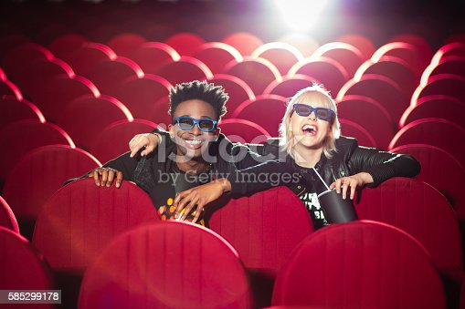 istock Multi ethnic young couple in the 3d cinema 585299178