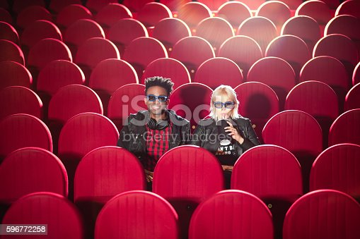 istock Multi ethnic young couple in the 3d cinema 596772258
