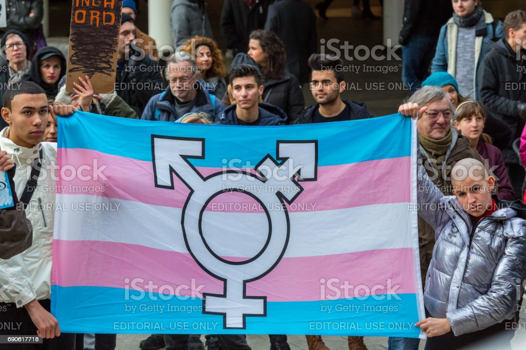 Multi ethnic youth holding HBTQ flag. stock photo