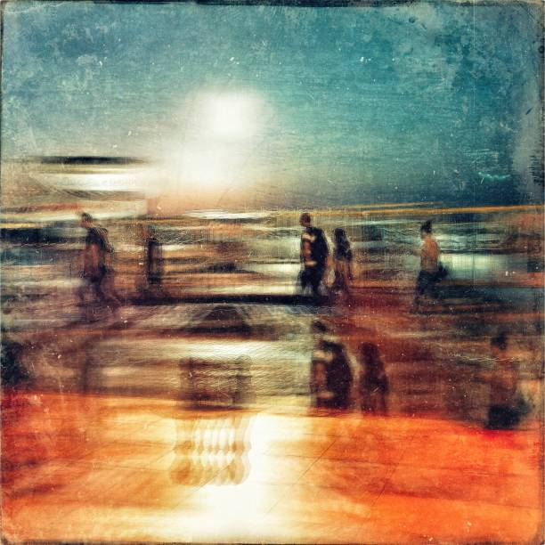 Multi exposure blurred motion view of people walking on the street at twilight
