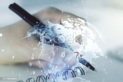 istock Multi exposure of abstract programming language hologram with world map and man hand writing in notepad on background, artificial intelligence and neural networks concept 1214633609