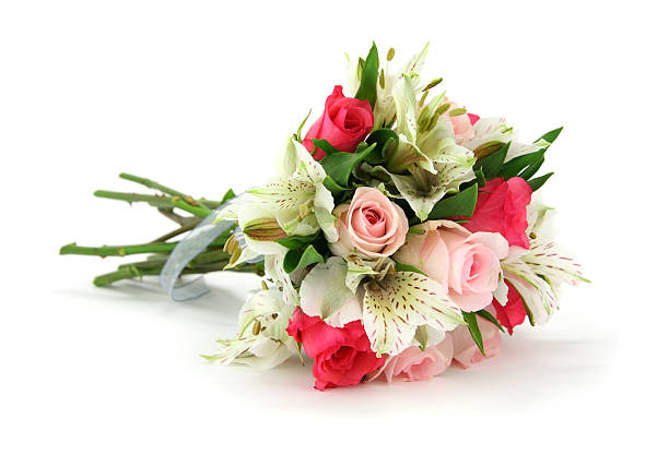 multi flower bouquet tied with white ribbon lying on side - 花球 個照片及圖片檔