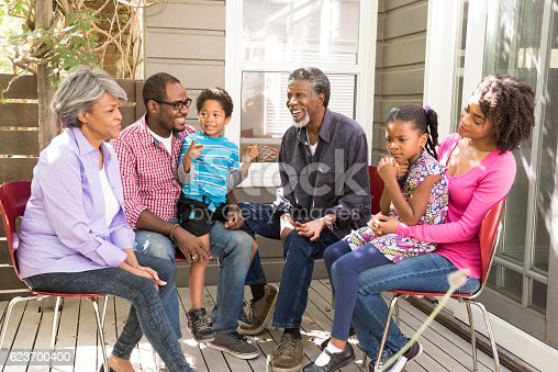 istock Multi generation African American family on decking outside house 623700400