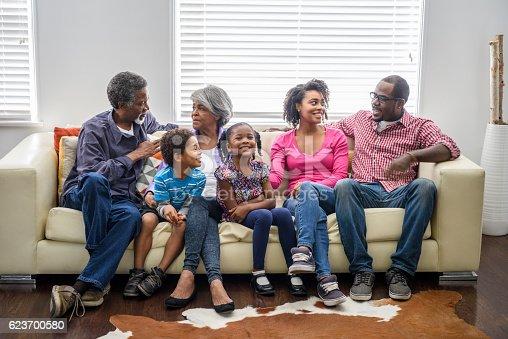 istock Multi generation African American family sitting on sofa 623700580