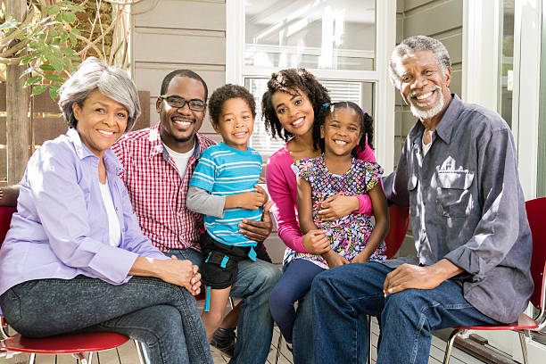 Multi generation African American family smiling, portrait stock photo
