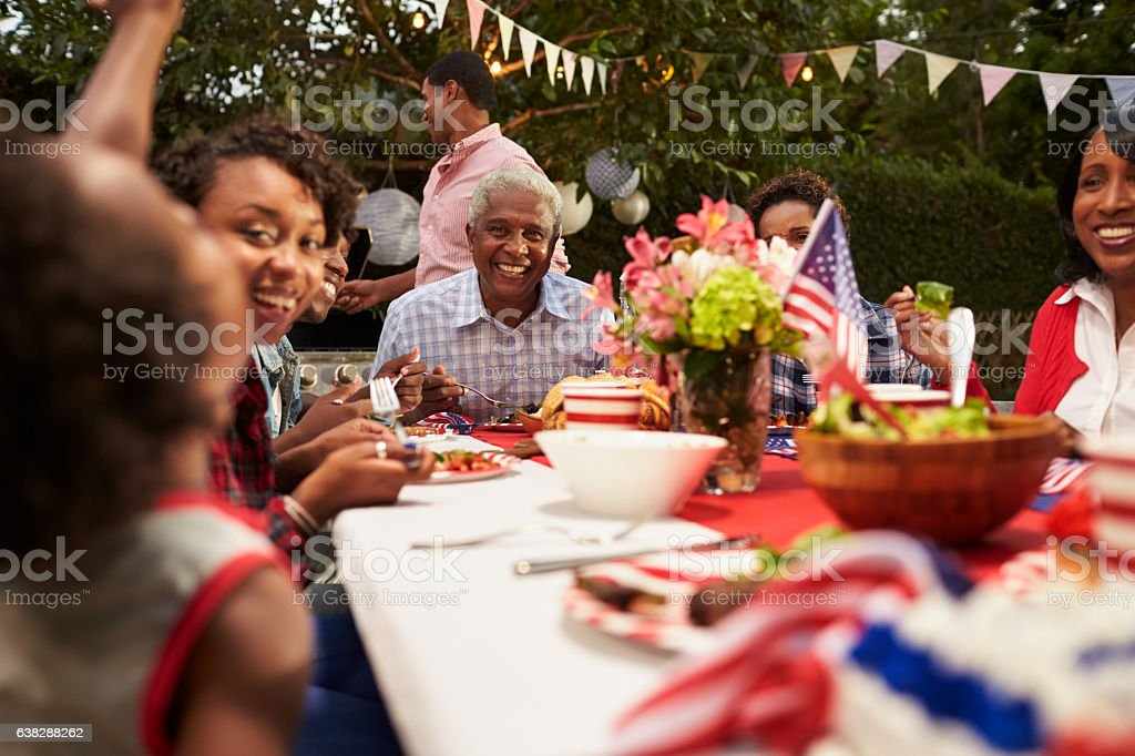 Multi generation black family at 4th July barbecue, close up stock photo