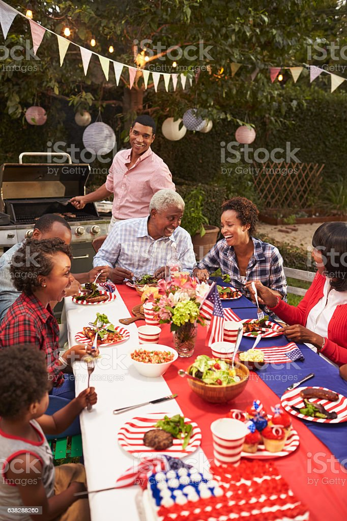 Multi generation black family at 4th July barbecue, vertical stock photo