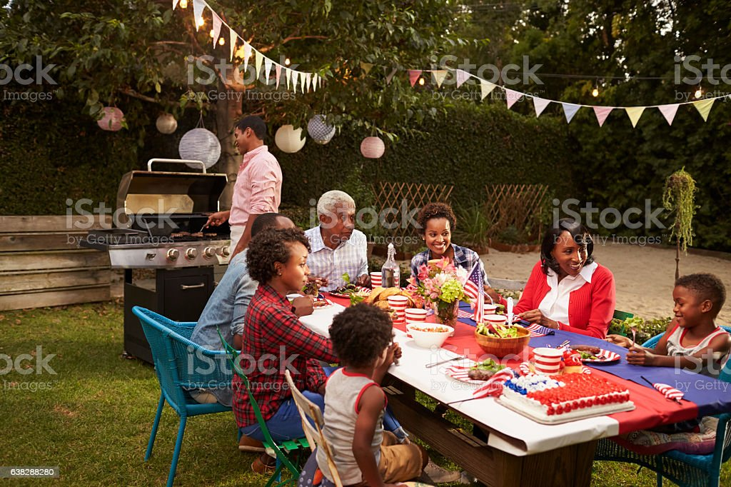 Multi generation black family having a 4th July barbecue stock photo
