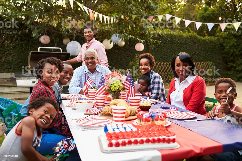 Multi generation black family having a 4th July garden party stock photo
