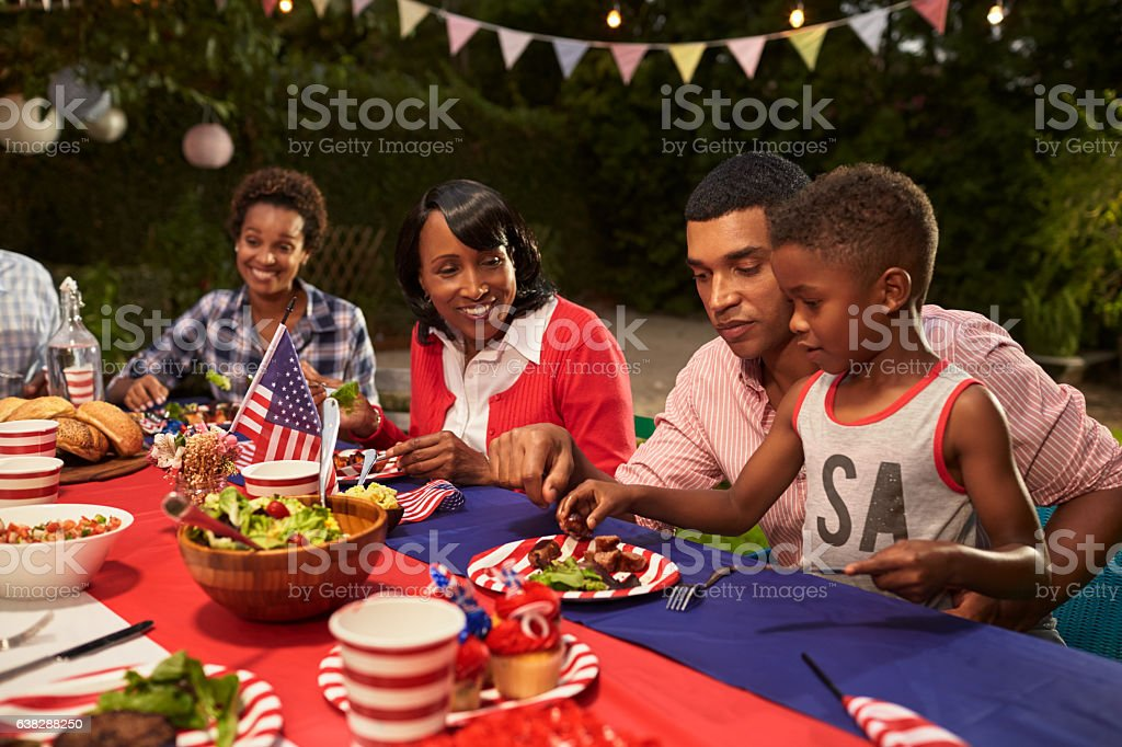Multi generation black family members at a 4th July barbecue stock photo