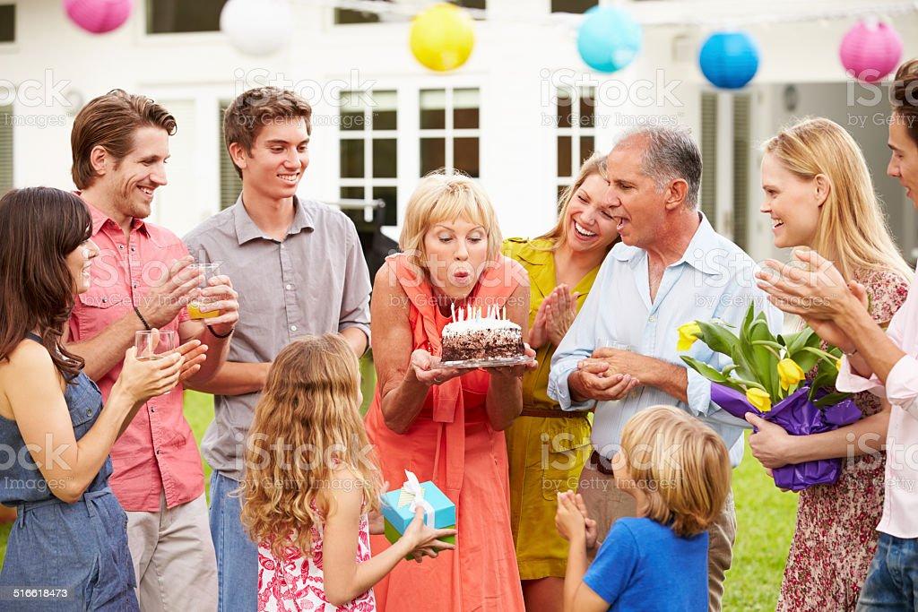 Multi Generation Family Celebrating Birthday In Garden stock photo